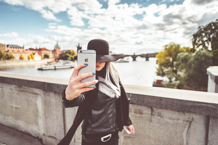 young-woman-taking-a-selfie-with-her-iphone-picjumbo-com
